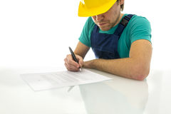 construction worker signing a form