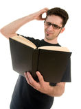 man confused reading a book